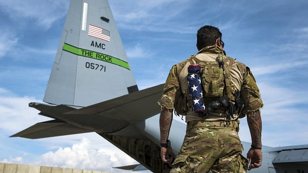 A U.S. Air Force pararescueman assigned to the 83rd Expeditionary Rescue Squadron at Bagram Airfield, Afghanistan, stands by before taking off in a U.S. Air Force C-130J Super Hercules for a training jump Mar 4, 2018.
