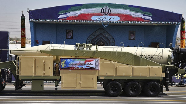 Iran's Khoramshahr missile is displayed by the Revolutionary Guard during a military parade marking the 37th anniversary of Iraq's 1980 invasion of Iran Friday