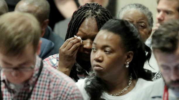 Tina Hunter, center, wipes her eyes as she watches from the gallery during Chicago Police Officer Jason Van Dyke's trial for the shooting death of her son Laquan McDonald, at the Leighton Criminal Court Building on Thursday, Sept. 20, 2018.