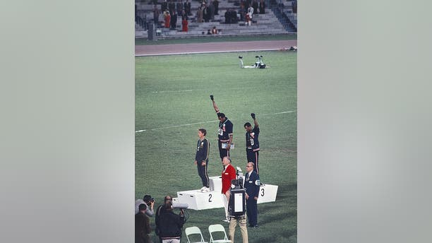 Tommie Smith and John Carlos are seen raising their fists at the Summer Olympics in 1968.