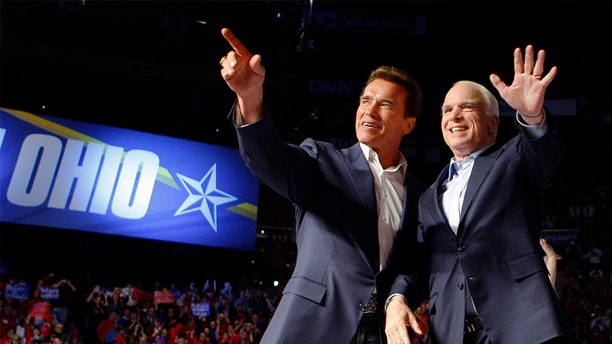 U.S. Republican presidential nominee Senator John McCain (R-AZ) (R) is joined by California Governor Arnold Schwarzenegger at a campaign rally in Columbus, Ohio October 31, 2008.