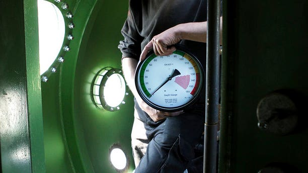 This is a 2008 file photo of submarine owner Peter Madsen inside the vessel.
