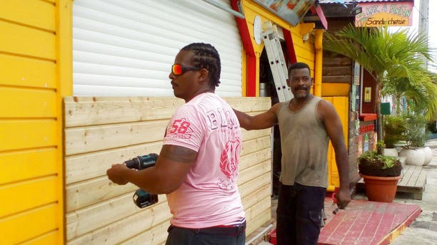 Men prepare for Hurricane Marina in the French Caribbean island of Guadeloupe on Monday.