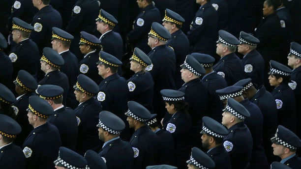 Police officers attending the funeral Mass.