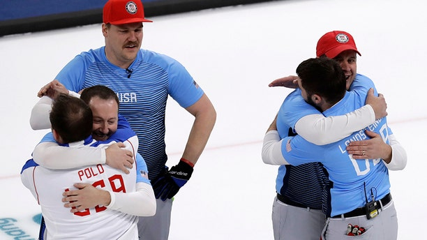 United States team celebrate during the men's curling finals match against Sweden at the 2018 Winter Olympics on Saturday.