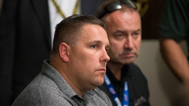Steve Grammas, left, president of the Las Vegas Police Protective Association, and Vice President Scott Nicholas, listen during a news conference on the Michael Bennett case, in Las Vegas, Sept. 29, 2017.