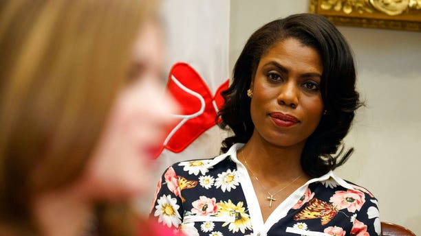"""FILE - In this Feb. 14, 2017, file photo, Omarosa Manigault-Newman, then an aide to President Donald Trump, watches during a meeting with parents and teachers in the Roosevelt Room of the White House in Washington. The White House is slamming a new book by ex-staffer Omarosa Manigault-Newman, calling her """"a disgruntled former White House employee."""" (AP Photo/Evan Vucci, File)"""