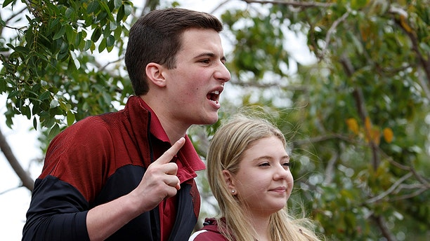 Marjory Stoneman Douglas High School student leaders Cameron Kasky and Jaclyn Corin speak to the crowd prior to boarding buses travelling to Tallahassee, Florida.