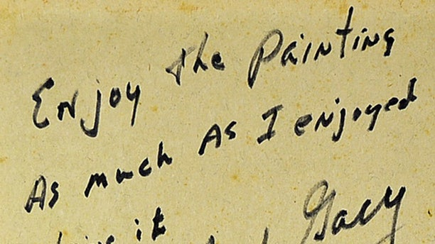 """A note from Gacy saying, """"Enjoy the painting as much as I enjoyed doing it.,"""" can be found on the back of his """"Hi Ho Around the Campfire"""" painting."""