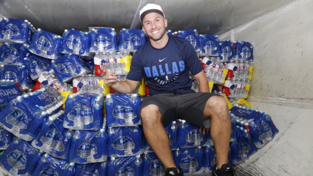 Dallas Mavericks' J.J. Barea with supplies he transported to Puerto Rico using the team's plane.