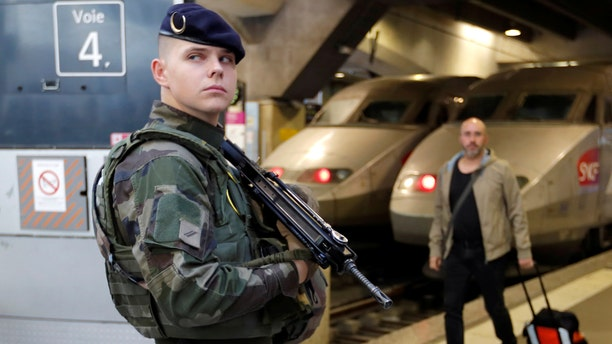 A french soldier poses as he patrols inside the Montparnasse train station in Paris, France, October 2, 2017.