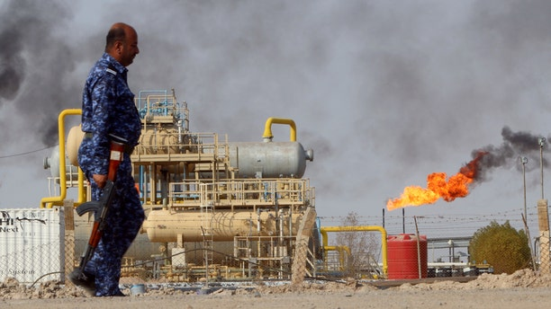 A member of the Oil Police Force is seen at Nahran Umran field north of Basra, Iraq, Sept. 8, 2017.