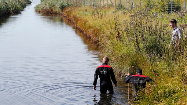 Police search a waterway for body remains related to the ongoing Kim Wall murder investigation at the west coast of Amager close to Copenhagen, Denmark, Wednesday, Aug. 23, 2017.