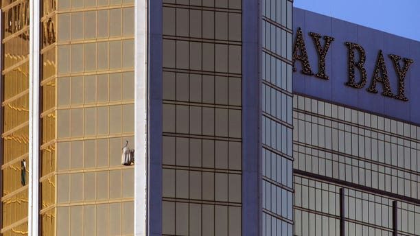 Drapes billow out of a broken window at the Mandalay Bay resort and casino Monday, Oct. 2, 2017, on the Las Vegas Strip following a deadly shooting at a music festival in Las Vegas. A gunman was found dead inside a hotel room.