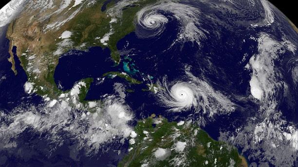 Hurricane Maria (below) and Hurricane Jose (top) are both seen in the Atlantic Ocean in this NOAA's GOES East satellite image.