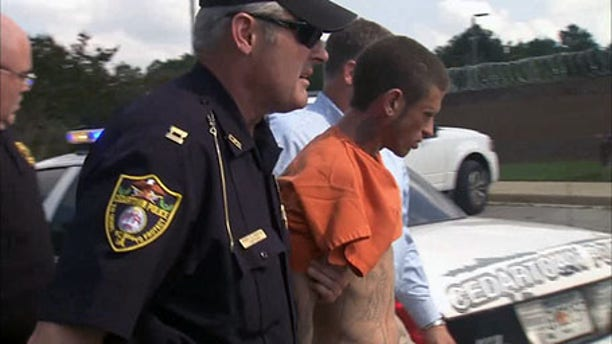 Seth Brandon Spangler is taken into custody following his arrest in Det. Hearne's murder Friday afternoon.