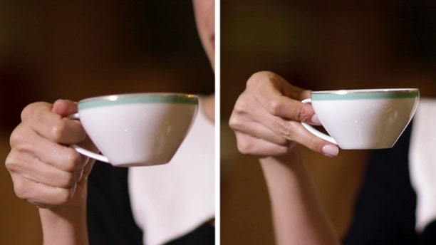 The correct way to hold a coffee cup (left) and a tea cup (right).