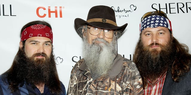 """This image released by Starpix shows TV personalities,from left, Jep Robertson, Si Robertson, and Willie Robertson, from the A&E series """"Duck Dynasty,"""" at the Sherri Hill Fashion Show, Monday, Sept. 9, 2013, in New York. The Robertsons attended  to support Willie's daughter Sadie Robertson who modeled several outfits for the show. (AP Photo/Starpix, Marion Curtis)"""