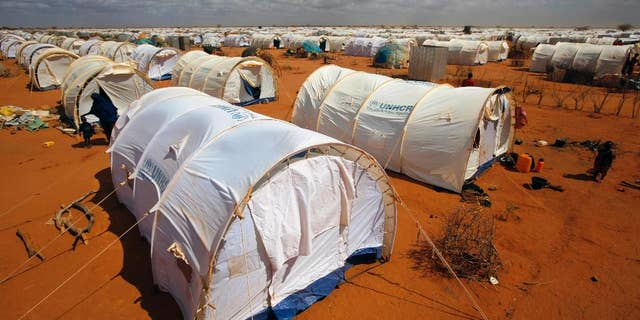 FILE - In this Friday, Aug. 5, 2011, file photo, tents are seen at the UNHCR's Ifo Extension camp outside Dadaab, eastern Kenya 62 miles from the Somali border.(AP Photo/Jerome Delay, File)