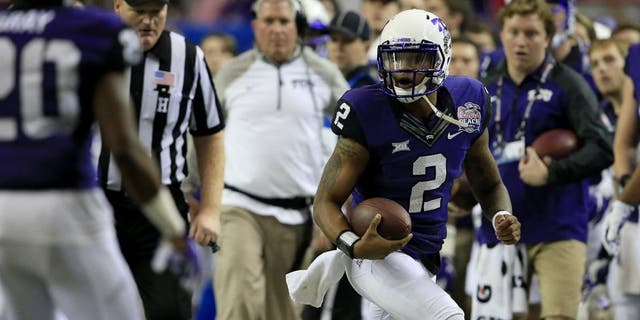 Dec 31, 2014; Atlanta , GA, USA; TCU Horned Frogs quarterback Trevone Boykin (2) runs the ball during the second quarter in the 2014 Peach Bowl against the Mississippi Rebels at the Georgia Dome. Mandatory Credit: Paul Abell/CFA Peach Bowl via USA TODAY Sports