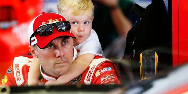 HOMESTEAD, FL - NOVEMBER 20: Kevin Harvick, driver of the #4 Budweiser/Jimmy John's Chevrolet, spends time with his son Keelan Harvick in the garage area during practice for the NASCAR Sprint Cup Series Ford EcoBoost 400 at Homestead-Miami Speedway on November 20, 2015 in Homestead, Florida. (Photo by Jonathan Ferrey/NASCAR via Getty Images)