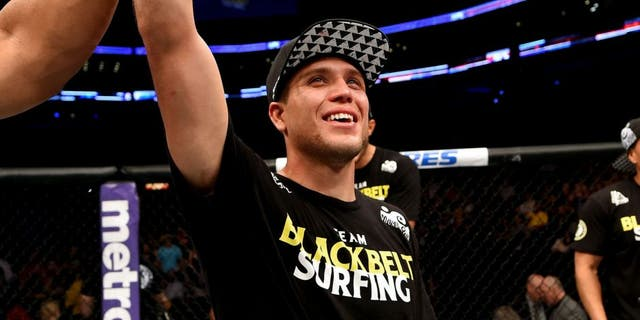 NEW ORLEANS, LA - JUNE 06: Brian Ortega celebrates his victory over Thiago Tavares in their featherweight bout during the UFC event at the Smoothie King Center on June 6, 2015 in New Orleans, Louisiana. (Photo by Josh Hedges/Zuffa LLC/Zuffa LLC via Getty Images)