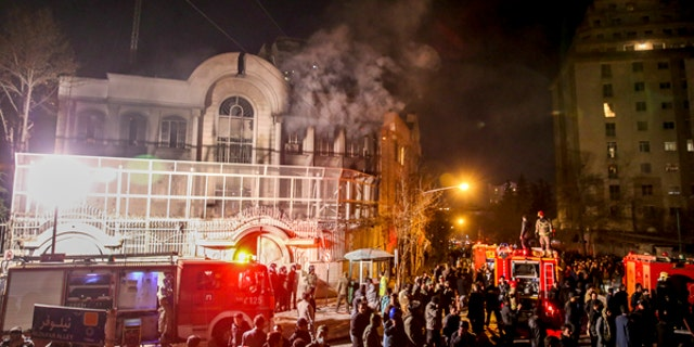Jan. 3, 2016: Smoke rises as Iranian protesters set fire to the Saudi embassy in Tehran.