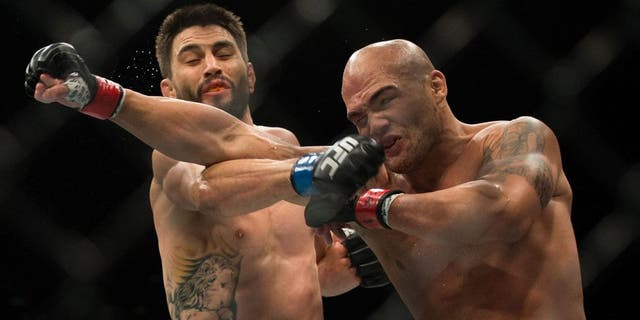 LAS VEGAS, NV - JANUARY 02: (R-L) Robbie Lawler exchanges punches with Carlos Condit in their welterweight championship fight during the UFC 195 event inside MGM Grand Garden Arena on January 2, 2016 in Las Vegas, Nevada. (Photo by Brandon Magnus/Zuffa LLC/Zuffa LLC via Getty Images)