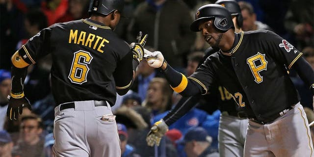 CHICAGO, IL - APRIL 28: Starling Marte #6 of the Pittsburgh Pirates is greeted by Andrew McCutchen #22 after hitting a two run home run in the 4th inning against the Chicago Cubs at Wrigley Field on April 28, 2015 in Chicago, Illinois. (Photo by Jonathan Daniel/Getty Images)