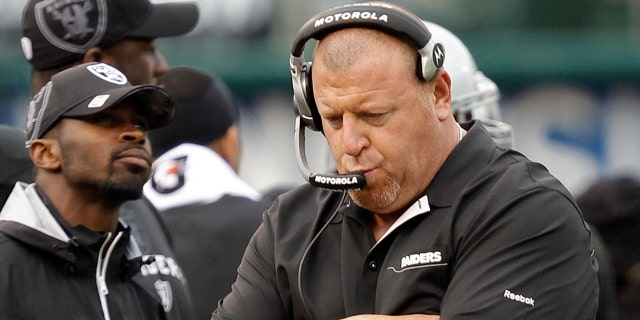 Oakland Raiders head coach Tom Cable walks on the sideline against the Indianapolis Colts in the second quarter of an NFL football game in Oakland, Calif., Sunday, Dec. 26, 2010. (AP Photo/Marcio Jose Sanchez)