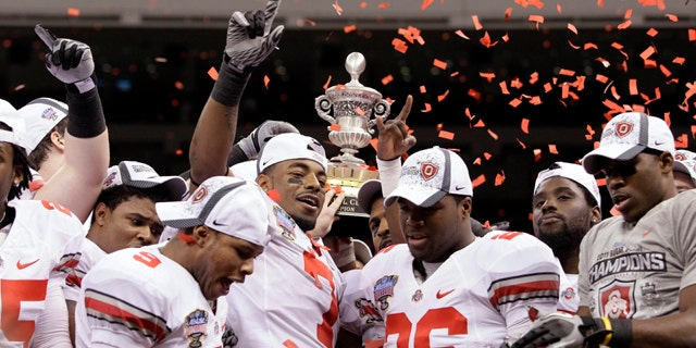 Jan. 4: Ohio State players hold up the Sugar Bowl trophy after beating Arkansas 31-26 in the NCAA college football game at the Louisiana Superdome in New Orleans.