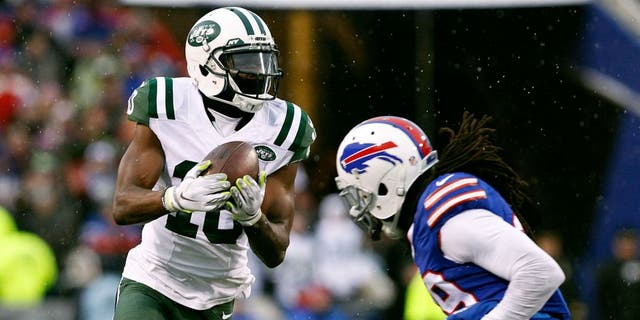 Jan 3, 2016; Orchard Park, NY, USA; New York Jets wide receiver Kenbrell Thompkins (10) cannot hold on to this pass late in the game as Buffalo Bills running back Karlos Williams (29) defends during the second half at Ralph Wilson Stadium. Bills beat the Jets 22-17. Mandatory Credit: Kevin Hoffman-USA TODAY Sports