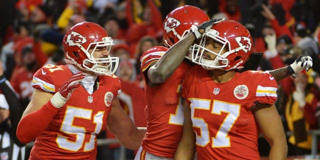 Jan 3, 2016; Kansas City, MO, USA; Kansas City Chiefs linebacker D.J. Alexander (57) is congratulated after blocking a punt during the second half against the Oakland Raiders at Arrowhead Stadium. The Chiefs won 23-17. Mandatory Credit: Denny Medley-USA TODAY Sports