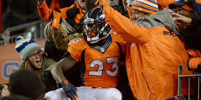 Jan 3, 2016; Denver, CO, USA; Denver Broncos running back Ronnie Hillman (23) celebrates scoring a touchdown in the fourth quarter against the San Diego Chargers at Sports Authority Field at Mile High. The Broncos defeated the Chargers 27-20. Mandatory Credit: Ron Chenoy-USA TODAY Sports
