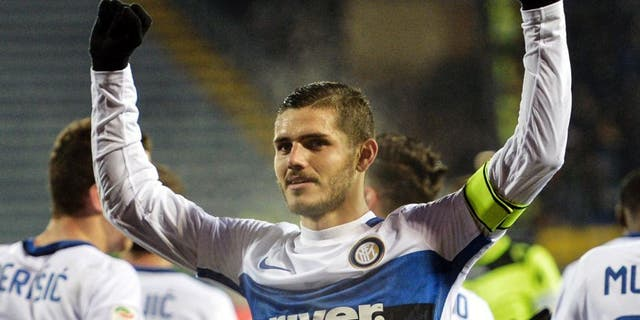 """Inter Milan's forward from Argentina Mauro Icardi celebrates after scoring during the Italian Serie A football match Empoli vs Inter Milan, on January 6, 2016 at Empoli's """"Carlo Castellani"""" comunal stadium. AFP PHOTO / ANDREAS SOLARO / AFP / ANDREAS SOLARO (Photo credit should read ANDREAS SOLARO/AFP/Getty Images)"""