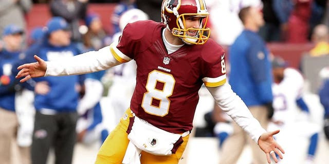 Dec 20, 2015; Landover, MD, USA; Washington Redskins quarterback Kirk Cousins (8) celebrates after throwing a touchdown pass to Redskins wide receiver DeSean Jackson (not pictured) against the Buffalo Bills in the third quarter at FedEx Field. The Redskins won 35-25. Mandatory Credit: Geoff Burke-USA TODAY Sports