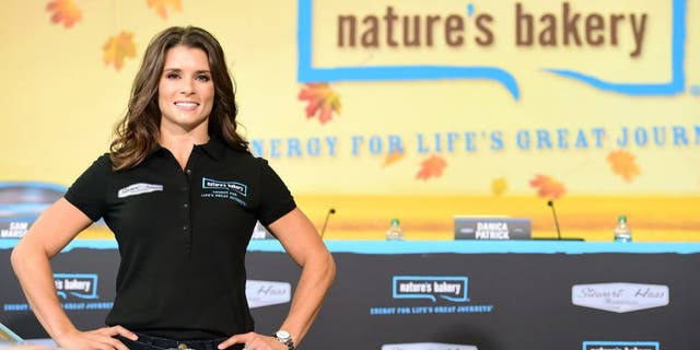 KANNAPOLIS, NC - AUGUST 18: Danica Patrick, driver of the #10 Stewart-Haas Racing Chevrolet, poses for a photo opportunity after she announced a multiyear deal partnership with Nature's Bakery during a press conference on August 18, 2015 in Kannapolis, North Carolina. The partnership will begin with the 2016 NASCAR Sprint Cup Series season. (Photo by Jared C. Tilton/Getty Images for Stewart-Haas Racing)