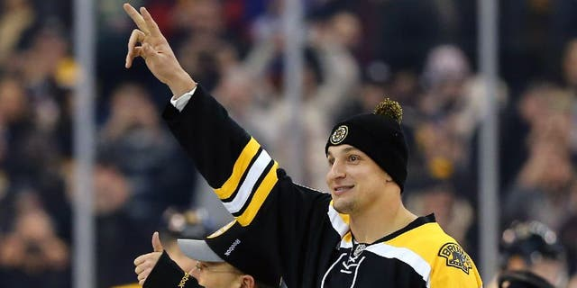 BOSTON, MA - FEBRUARY 07: Rob Gronkowski of the New England Patriots waves to fans before the game between the Boston Bruins and the New York Islanders at TD Garden on February 7, 2015 in Boston, Massachusetts. (Photo by Maddie Meyer/Getty Images)