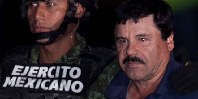 """Jan. 8, 2016: Mexican drug lord Joaquin """"El Chapo"""" Guzman, right, is escorted by soldiers and marines to a waiting helicopter, at a federal hangar in Mexico City"""