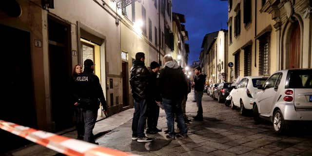 Jan. 9, 2016: Italian police officers stand outside an apartment where 35-year-old American woman Ashley Oslen was found dead, in Florence, Italy