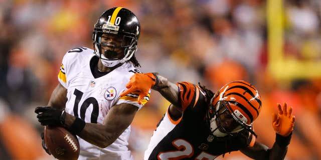 Pittsburgh Steelers wide receiver Martavis Bryant (10) is tackled by Cincinnati Bengals' Dre Kirkpatrick (27) during the second half of an NFL wild-card playoff football game Saturday, Jan. 9, 2016, in Cincinnati.