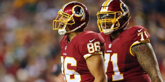LANDOVER, MD - JANUARY 10: Tight end Jordan Reed #86 of the Washington Redskins celebrates with teammate tackle Trent Williams #71 after scoring a second quarter touchdown against the Green Bay Packers during the NFC Wild Card Playoff game at FedExField on January 10, 2016 in Landover, Maryland. (Photo by Elsa/Getty Images)