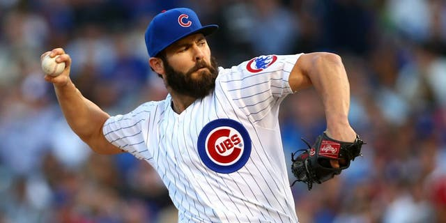 Oct 12, 2015; Chicago, IL, USA; Chicago Cubs starting pitcher Jake Arrieta (49) throws a pitch during the first inning against the St. Louis Cardinals in game three of the NLDS at Wrigley Field. Mandatory Credit: Jerry Lai-USA TODAY Sports