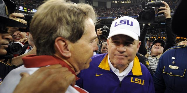 Jan 9, 2012; New Orleans, LA, USA; LSU Tigers head coach Les Miles (right) shakes hands with Alabama Crimson Tide head coach Nick Saban after the 2012 BCS National Championship game at the Mercedes-Benz Superdome. Mandatory Credit: John David Mercer-USA TODAY Sports