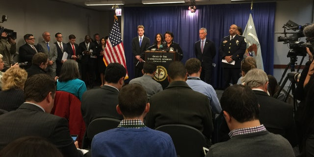 Attorney General Lynch at the podium, with Mayor Rahm Emanuel and Police Supt. Eddie Johnson, right.