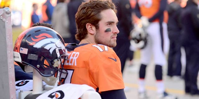 Jan 3, 2016; Denver, CO, USA; Denver Broncos quarterback Brock Osweiler (17) sits on the bench in the first quarter against the San Diego Chargers at Sports Authority Field at Mile High. The Broncos defeated the Chargers 27-20. Mandatory Credit: Ron Chenoy-USA TODAY Sports
