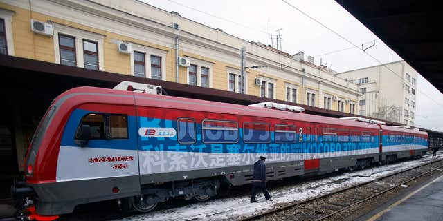 """Jan. 14, 2017: A railroad worker walks by the first train decorated with letters that read """"Kosovo is Serbian"""" written in twenty languages departing from the Belgrade to Mitrovica, Kosovo at Belgrade's railway station, Serbia."""