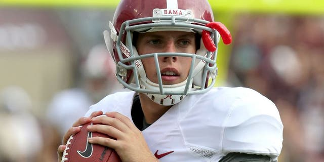 Sep 14, 2013; College Station, TX, USA; Alabama Crimson Tide quarterback Luke Del Rio (14) throws to stretch prior to the second half against the Texas A&M Aggies at Kyle Field. Mandatory Credit: Matthew Emmons-USA TODAY Sports