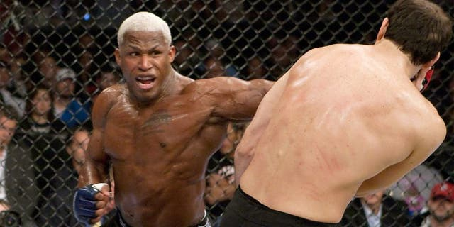ST. LOUIS - MAY 15: (L-R) Kevin Randleman punches Roger Gracie during their bout at the Strikeforce: Heavy Artillery event at the Scottrade Center on May 15, 2010 in St. Louis, Missouri. (Photo by Esther Lin/Forza LLC via Getty Images)