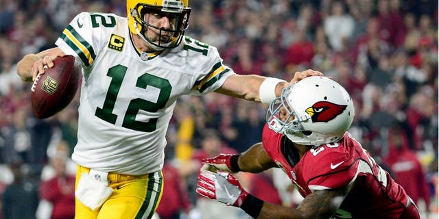 GLENDALE, AZ - JANUARY 16: Running back David Johnson #31 of the Arizona Cardinals is hit by inside linebacker Jake Ryan #47 of the Green Bay Packers during the first quarter of the NFC Divisional Playoff Game at University of Phoenix Stadium on January 16, 2016 in Glendale, Arizona. (Photo by Harry How/Getty Images)